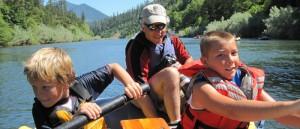 Kids practice rowing a raft